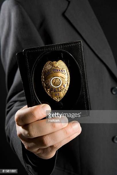 A police officer holding ID