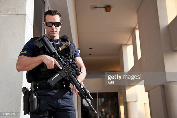 police officer holding rifle - weapon stock pictures, royalty-free photos & images