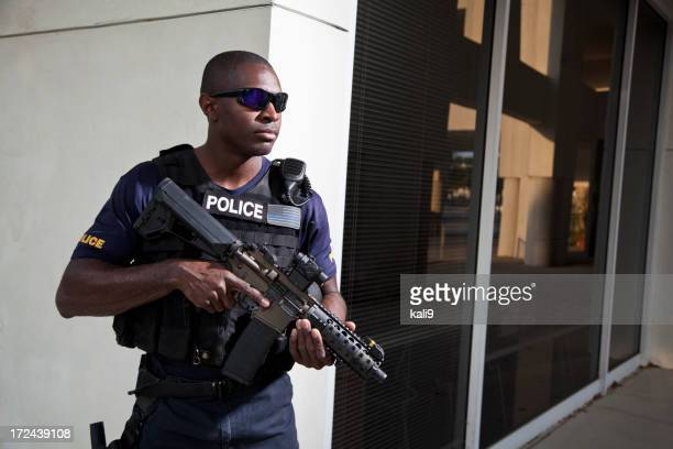 Police officer holding rifle