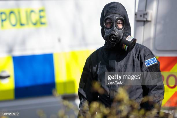 A police officer in a protective suit and mask works near the scene where former doubleagent Sergei Skripal and his daughter Yulia were discovered...