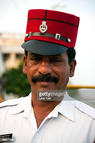 PONDICHERRY PUDUCHERRY INDIA A police officer in Pondicherry wearing a red kepi a leftover from the time the town was a French colony
