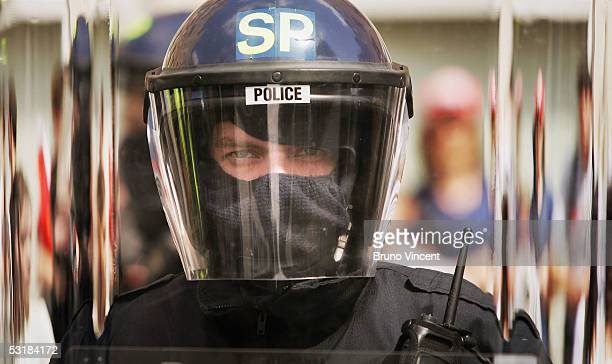 A police officer in riot gear stands as part of a cordon surrounding a group of anarchist protestors during a protest march on July 2 2005 in...