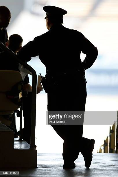 A police officer in silhouette looks on during the Los Angeles Dodgers game against the Houston Astros on May 27 2012 at Dodger Stadium in Los...