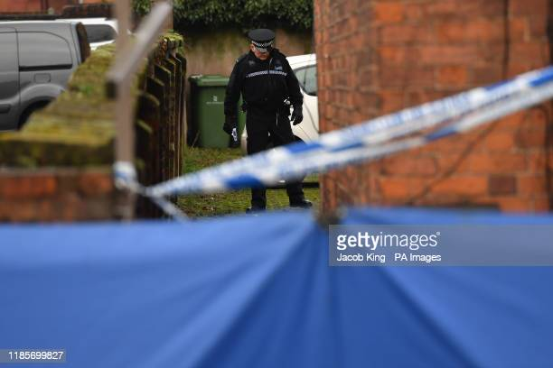 A police officer in Woverhampton Road Stafford as forensic officers continue their search at the property linked to London Bridge terrorist attacker...