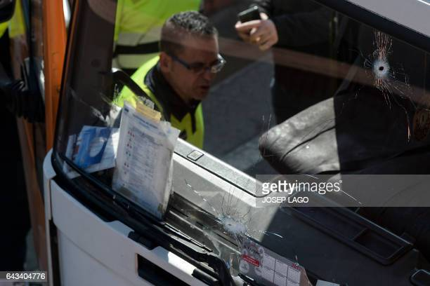A police officer inspects a butane gas delivery truck which had to be shot to stop it in Barcelona on February 21 2017 Spanish police said today they...