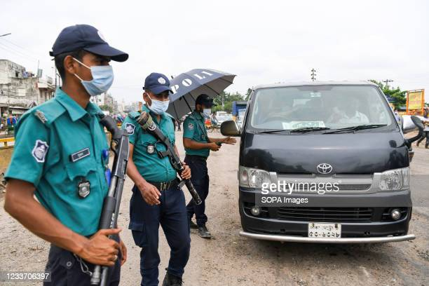 Police officer inspects the vehicle at a checkpoint at the Gabtoli area during the covid-19 lockdown. Vehicle owners need to provide valid...