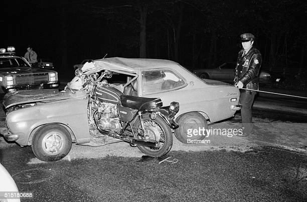 A police officer investigates the scene of a fatal auto accident between a motorcycle and car in the Kingsbridge section of the Bronx The driver of...