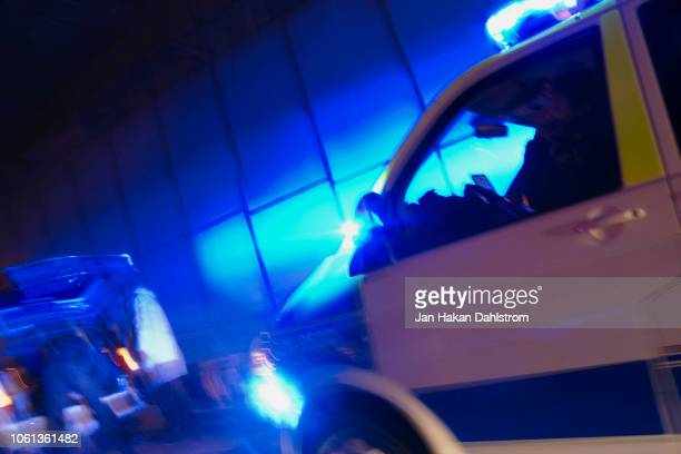 police officer investigating a car - police vehicle lighting stock pictures, royalty-free photos & images