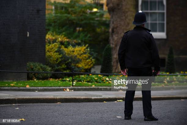 A Police officer is pictured at Downing Street the day that Britain's International Development Secretary Priti Patel resigned London on November 8...