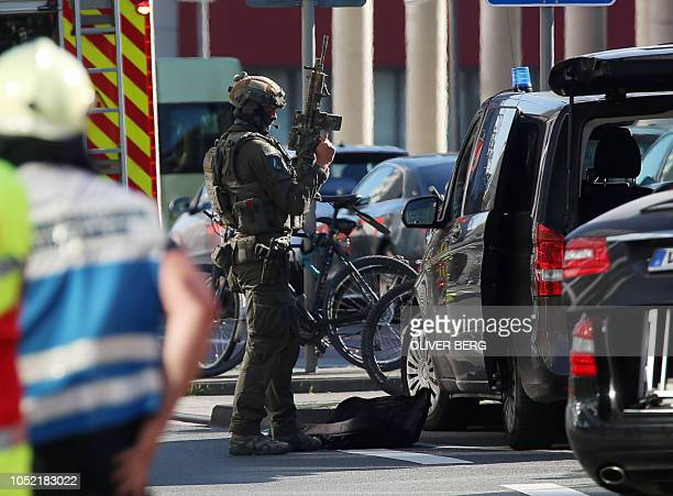 A police officer is pictured near the Central Station in Cologne western Germany on October 15 2018 German police on October 15 2018 closed down...