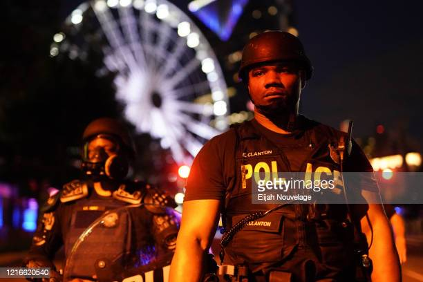 A police officer is seen during a demonstration on May 31 2020 in Atlanta Georgia Across the country protests have erupted following the recent death...