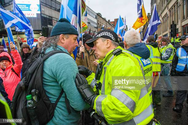 A police officer is seen harassing a photographer during a confrontation despite being told that the photographer is a member of the press numerous...