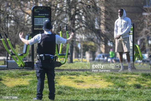 Police Officer is seen speaking to people exercising on Clapham Common on March 25 2020 in London England British Prime Minister Boris Johnson...