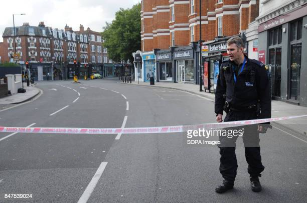 A police officer is seen standing around the Parsons Green Underground Station Several injured at Parsons Green as passengers report seeing device on...