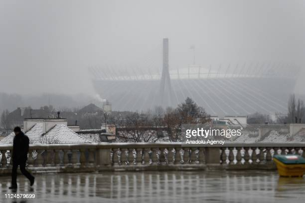 Police officer is seen walking as the National stadium where the summit on peace and security in the Middle East will take place is seen in the...