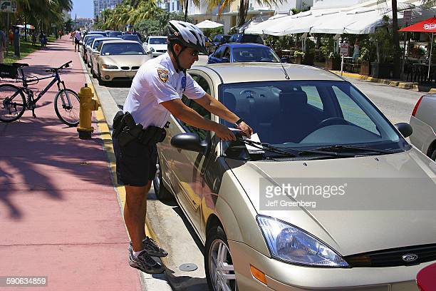 Police Officer Issuing A Parking Ticket