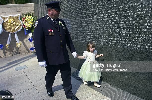 Police Officer Jim Smith walks with his daughter, Patricia, past the police memorial wall at Battery Park City. Patricia's mother, Police Officer...