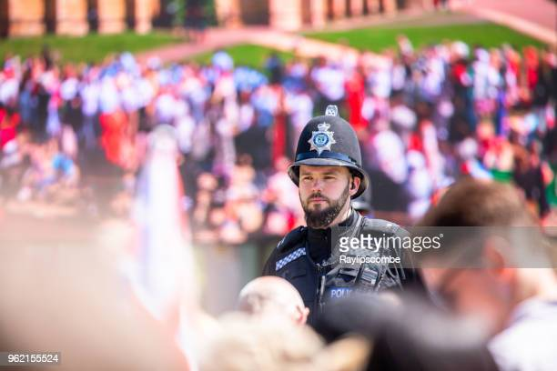 police officer keeping an eye on the gathering crowds of people at windsor great park to celebrate the marriage of meghan markle and prince harry - meghan stock photos and pictures