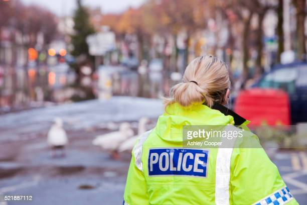 police officer keeping guard on main street - police stock pictures, royalty-free photos & images