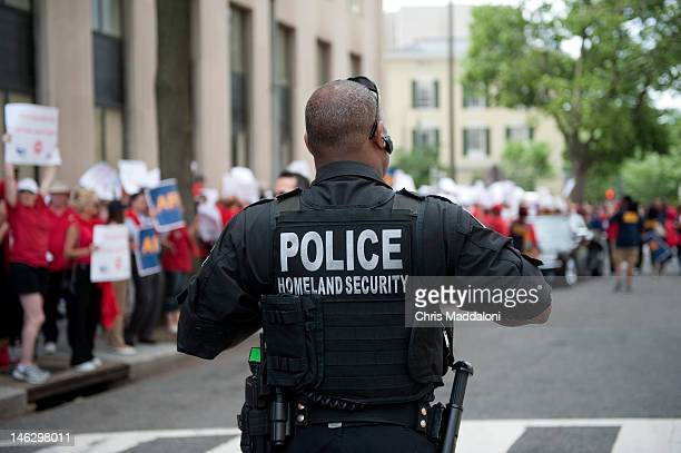 A police officer keeps an eye on the American Federation of Government Employees rally in front of the Veterans Affairs building The AFGE were there...