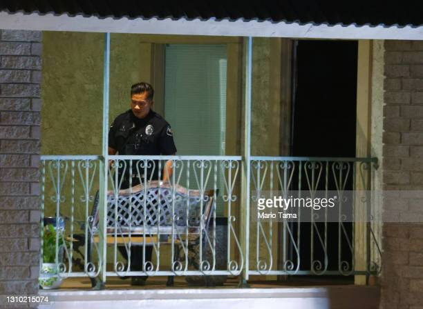 Police officer keeps watch at an office building where four people, including a child, were killed in a shooting on March 31, 2021 in Orange,...