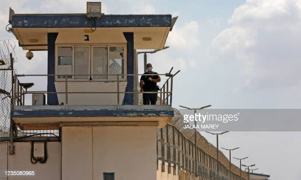 Police officer keeps watch from an observation tower at the Gilboa Prison in northern Israel on September 6, 2021. - Six Palestinians escaped from a...