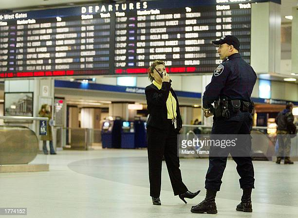 A police officer keeps watch in Penn Station February 10 2003 in New York City Police enhanced security at airports train stations subways and hotels...
