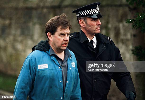 A police officer leading a man towards Dunblane primary school Scotland shortly after the shooting incident on the premises The Dunblane school...