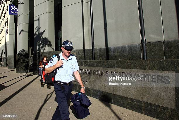 Police Officer leaves from the Queensland Police Headquarters on July 3 2007 in Brisbane Australia Authorities have confirmed that Australian police...