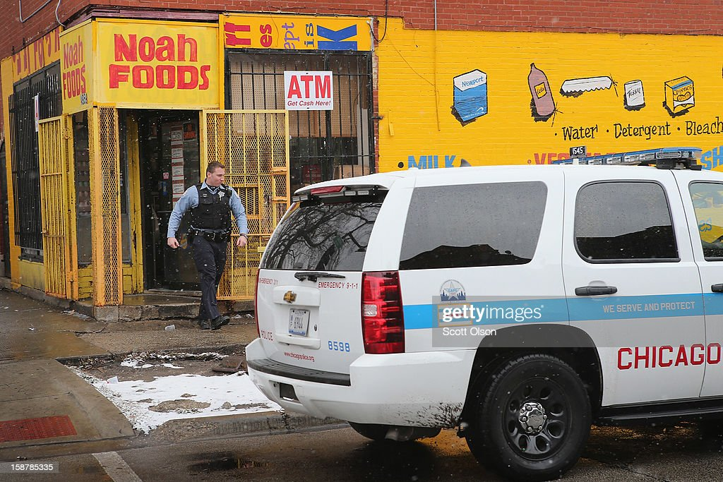 A police officer leaves Noah Foods December 28, 2012 in Chicago, Illinois. Nathaniel Jackson, believed to be the 500th murder victim of the year in Chicago, was shot in the head and killed outside the store on December 27. After news organizations began reporting about his murder, the Chicago Police Department's News Affairs Office issued a statement stating Chicago's murder total remains at 499 because classification of one death investigation remains pending. They would not specify which death is pending. The total number of murders in the city has only once exceeded 500 victims since 2004. The murder rate is up about 11 percent from 2011, much of which is attributed to growing gang violence.