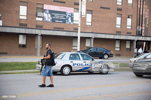 A police officer leaves the scene of a shooting at Fern Creek High School September 30 2014 in Louisville Kentucky Police say a male suspect was...