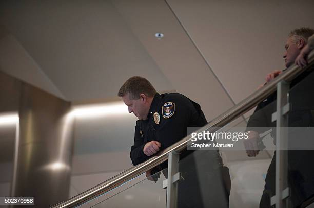 A police officer looks down into the rotunda of the Mall of America in Bloomington MN observing the planned Black Lives Matter demonstration on...