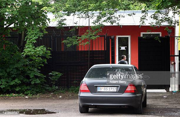 A police officer looks inside the gate of the clubhouse of the motorcycle gang Bandidos Del Este on June 7 2012 in Hennigsdorf just outside of Berlin...