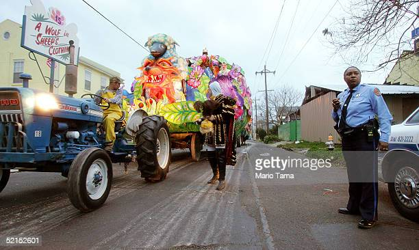 A police officer looks on as a float passes during the historic Proteus parade founded in 1882 during Mardi Gras festivites February 7 2005 in New...