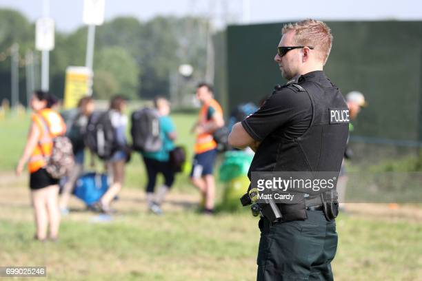 A police officer looks on as the gates open at the Glastonbury Festival amid heightened security at Worthy Farm in Pilton on June 21 2017 near...