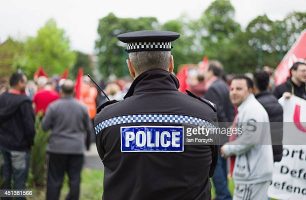 A police officer looks on during a demonstration aimed to celebrate diversity on Teesside and which was held to voice opposition against the English...