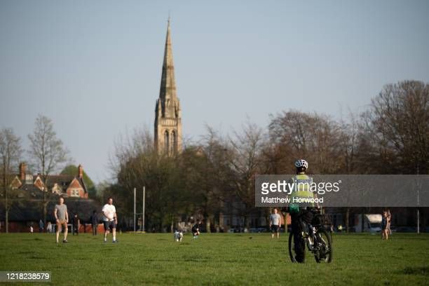Police officer looks on in Roath Recreation Ground on April 11, 2020 in Cardiff, United Kingdom. Police have stepped up patrols to prevent people...