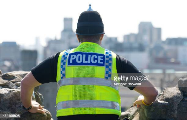 A police officer looks over the city from Cardiff Castle as preparations continue ahead of the 2014 Nato summit on September 2 2014 in Cardiff Wales...