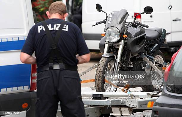 A police officer makes notes about a motorcycle that has been seized at the clubhouse of the motorcycle gang Bandidos Del Este on June 7 2012 in...