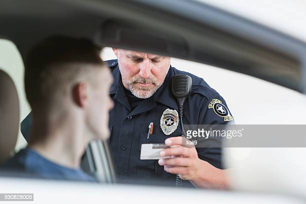 police officer making a traffic stop - identity stock photos and pictures