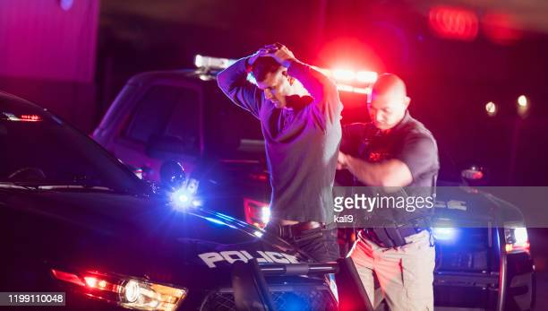 police officer making an arrest - criminal stock pictures, royalty-free photos & images