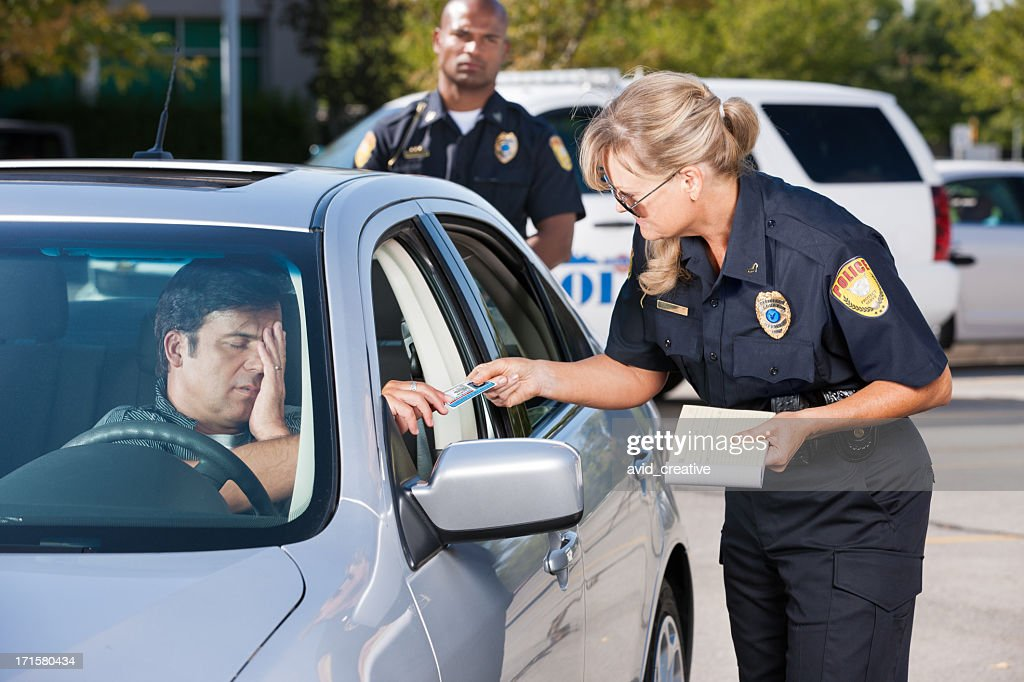 Police Officer Making Traffic Stop : Stock Photo