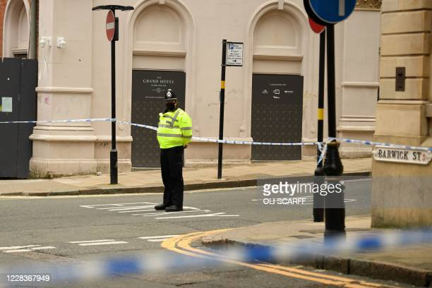 Police officer mans a cordon at the junction of Church Street and Barwick Street, following a major stabbing incident in the centre of Birmingham,...