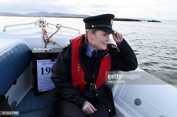 Police officer Margaret Byrne is pictured as she escorts a ballot box to the residents of Inishfree Island off the west coast of Ireland on February...