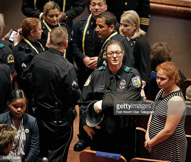 DART police officer Misty McBride wounded in the attack attends a memorial for five Dallas and DART police officers shot to death in last week's...