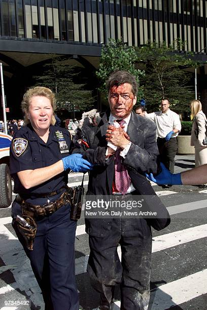 Police Officer Moira Smith helps Edward Nicholls a broker at Aon, from the south tower of the World Trade Center minutes before its collapse. She...