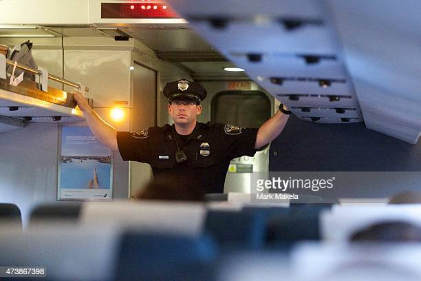 A police officer monitors activity on the first Amtrak northbound service from 30th Street Station a 553am departing train after last week's...
