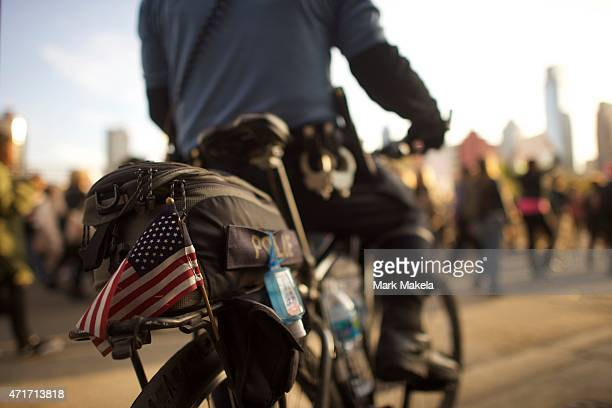 Police officer monitors protestors marching over the death of Freddie Gray outside City Hall on April 30, 2015 in Philadelphia, Pennsylvania. Freddie...