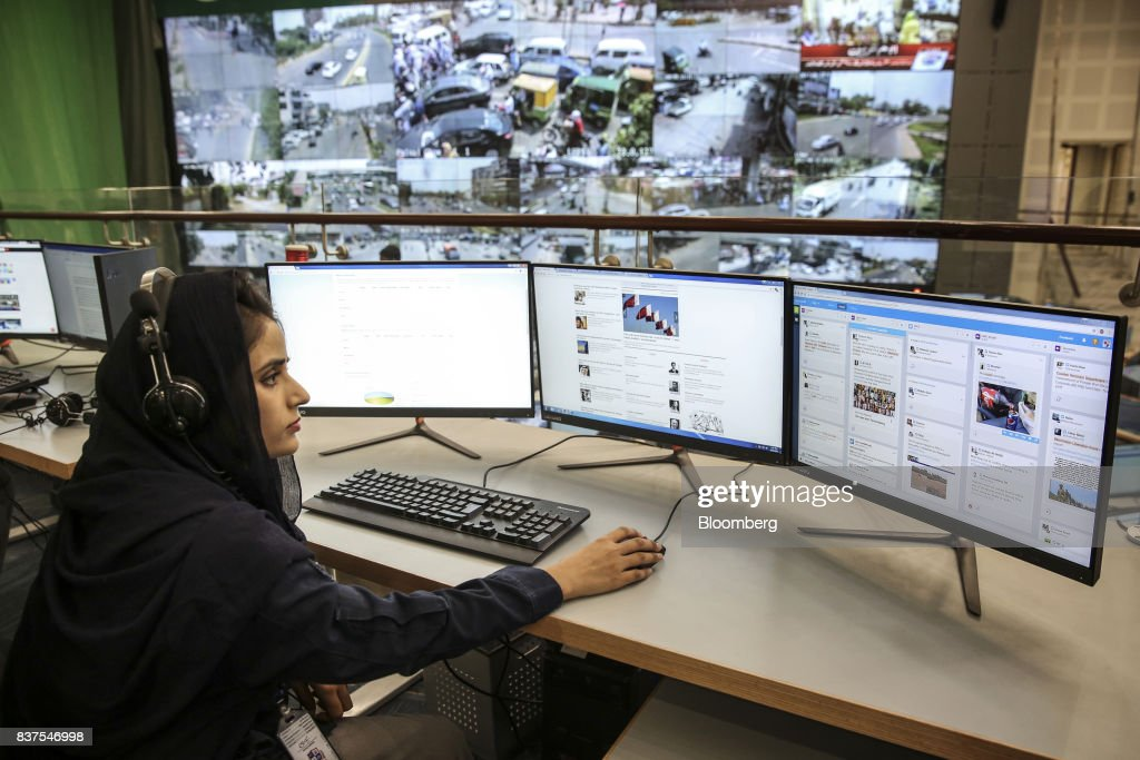 A police officer monitors various social media channels at the Punjab Police Integrated Command Control and Communication Center in Lahore Pakistan...