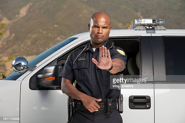 Police Officer Motioning to Stop